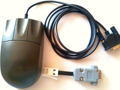 Picture of a Serial Mouse and a cable adaptor for QL